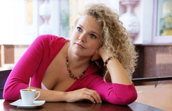 Young pretty woman in street cafe Stock Photography