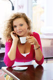 Young pretty woman in street cafe Royalty Free Stock Photography