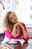 Young pretty woman in street cafe Royalty Free Stock Photos