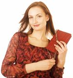 Young pretty woman in studio with little purse Royalty Free Stock Images