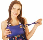 Young pretty woman in studio with little purse Royalty Free Stock Photos