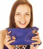 Young pretty woman in studio with little purse Stock Photos