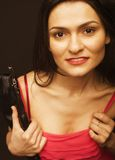Young pretty woman in studio with little purse Stock Image