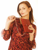 Young pretty woman in studio with little purse Stock Photo