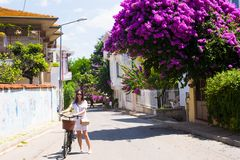 Young pretty woman on summer vacation biking at Stock Image