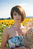 Woman in field with sunflowers Stock Photography