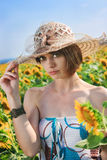 Woman with sunflowers Stock Photography