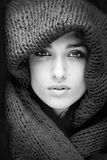 Young pretty woman in sweater and scarf all over her face black and white Stock Images