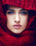 Young pretty woman in sweater and scarf all over her face Stock Photos