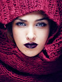Young pretty woman in sweater and scarf all over her face Stock Photo