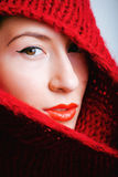 Young pretty woman in sweater and scarf all over her face Royalty Free Stock Photo