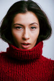 Young pretty woman in sweater and scarf all over her face Royalty Free Stock Photography