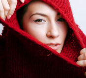 Young pretty woman in sweater and scarf all over her face Stock Images