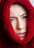 Young pretty woman in sweater and scarf all over her face Royalty Free Stock Images