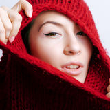Young pretty woman in sweater and scarf all over her face Royalty Free Stock Image