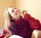 Young pretty woman in sweater and scarf all over her face, happy smiling winter people lifestyle concept Stock Image