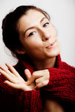 Young pretty woman in sweater and scarf all over her face, lifes Royalty Free Stock Image