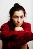 Young pretty woman in sweater and scarf all over her face, lifes Stock Image