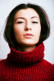 Young pretty woman in sweater and scarf all over her face, lifes Royalty Free Stock Photo