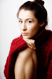 Young pretty woman in sweater and scarf all over her face, lifes Stock Photography