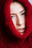 Young pretty woman in sweater and scarf all over Stock Photos