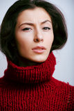 Young pretty woman in sweater and scarf all over Royalty Free Stock Photo