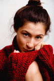 Young pretty woman in sweater and scarf all over her face, winter cold close up Royalty Free Stock Photography