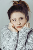 Young pretty woman in sweater and scarf all over her face, winter cold close up, lifestyle people concept Stock Images