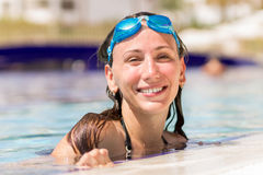Young pretty woman in swimming pool Stock Photo