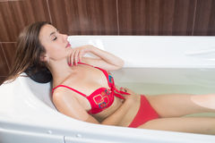 Young pretty woman takes mineral baths. At the medical center royalty free stock photography