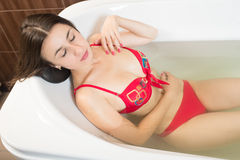 Young pretty woman takes mineral baths. At the medical center royalty free stock photos
