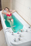 Young pretty woman takes mineral baths. At the medical center stock photography