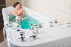 Young pretty woman takes mineral baths. At the medical center royalty free stock image