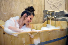 Young pretty woman taking a bubble bath Royalty Free Stock Image