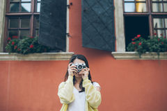 Young pretty woman taking picture with old camera Royalty Free Stock Photos