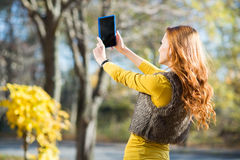 Young pretty woman taking selfie in the park Royalty Free Stock Images