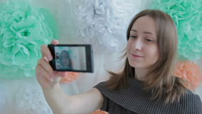 Young pretty woman taking selfie at photographic stock video footage