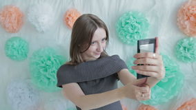 Young pretty woman taking selfie at photographic stock footage