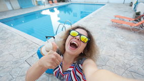 Young pretty woman taking selfie on vacation stock footage