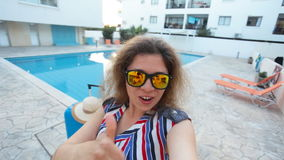 Young pretty woman taking selfie on vacation stock video footage