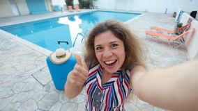 Young pretty woman taking selfie on vacation stock video