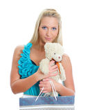 Young pretty woman with teddy bear and shop bag. Stock Images
