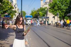Young pretty woman tourist in big city with map Stock Photo