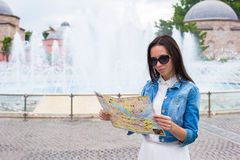 Young pretty woman tourist in big city with map Stock Image