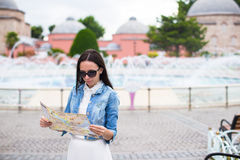 Young pretty woman tourist in big city with map Royalty Free Stock Photos