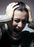 Young pretty woman in trouble, screaming in grief Royalty Free Stock Image