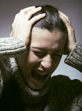Young pretty woman in trouble, screaming in grief Royalty Free Stock Photos