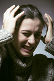 Young pretty woman in trouble, screaming in grief Stock Images