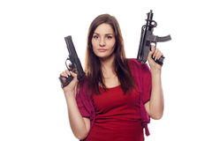 Young pretty woman with two guns Stock Photos
