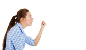 A young pretty woman upset, raising fist in the air Stock Photography